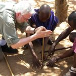 Robert Scheer making fire in Kenya